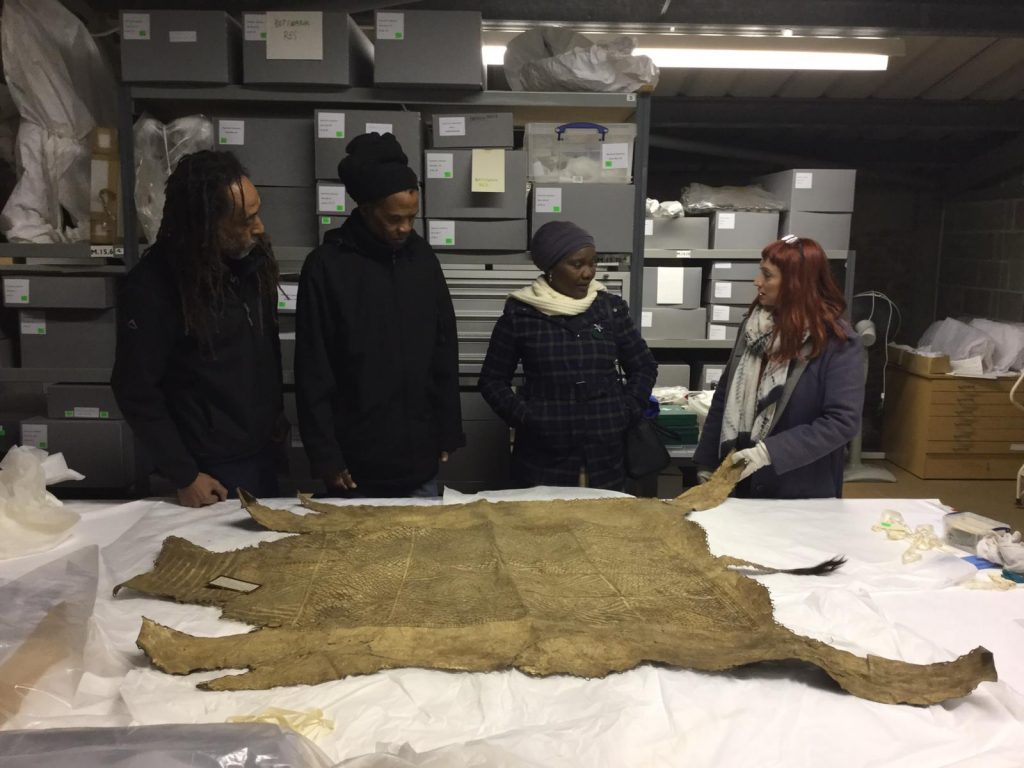 Tshepo, Scobie, Winani and Rachel  viewing objects in the store room